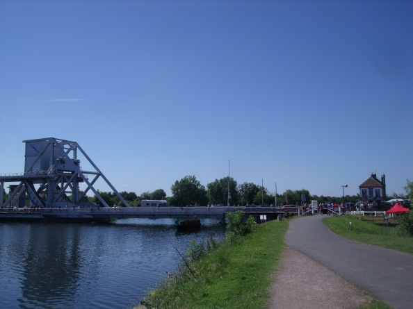 Looking back at the canal bridge and the Café Gondrée from downstream.
