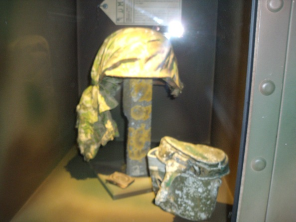 German helmet using a US parachute for camouflage.
